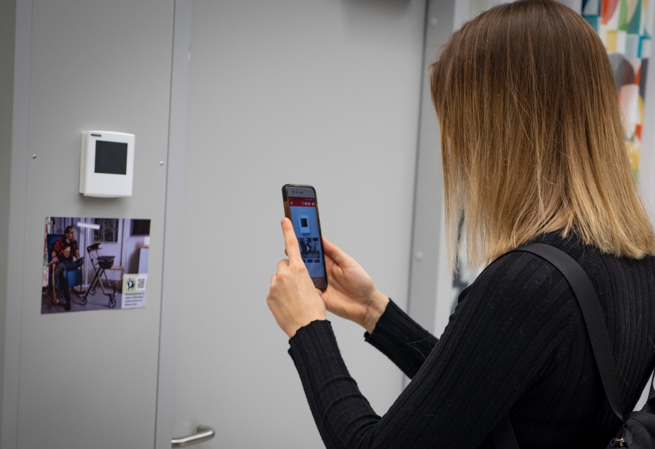Woman points a picture with mobile phone